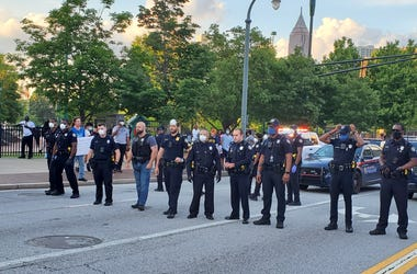 Atlanta police officers are shown on the first day of violent protests at Marietta Street and Centennial Olympic Park