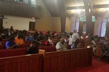 Residents hoping to cast ballots wait inside New Life Presbyterian Church in Atlanta Tuesday