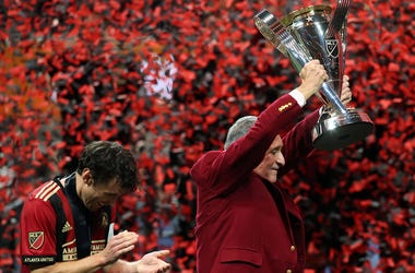 Atlanta United owner Arthur Blank holds the MLS Cup next to defender Michael Parkhurst (3) after defeating the Portland Timbers in the 2018 MLS Cup championship game at Mercedes-Benz Stadium.