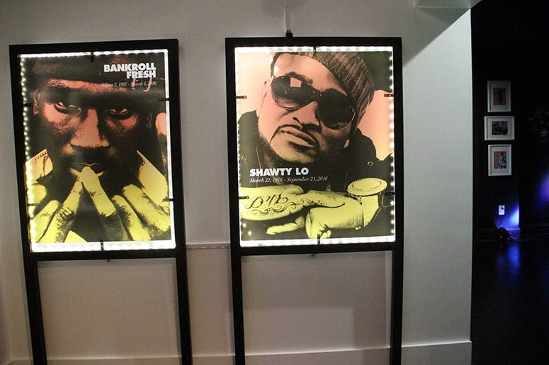 Photos of deceased Atlanta rappers Bankroll Fresh and Shawty Lo inside T.I.'s Trap Music Museum