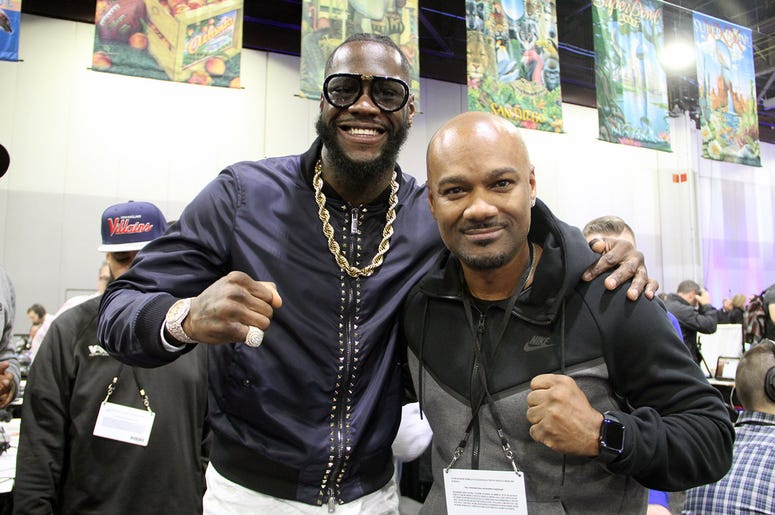Big Tigger with boxing champion Deontay Wilder on Radio Row during Super Bowl Experience in Atlanta