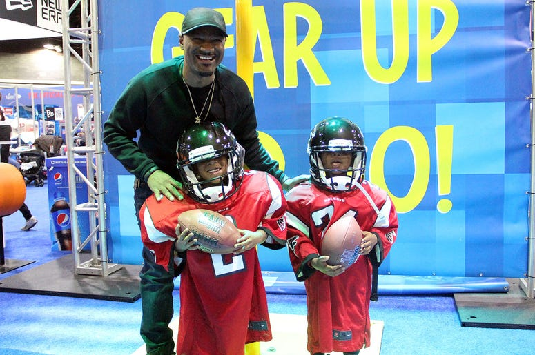 Big Tigger with kids in oversized Falcons uniforms