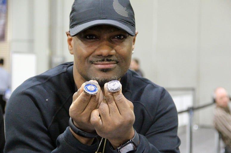 Big Tigger holding Warren Sapp's championship rings