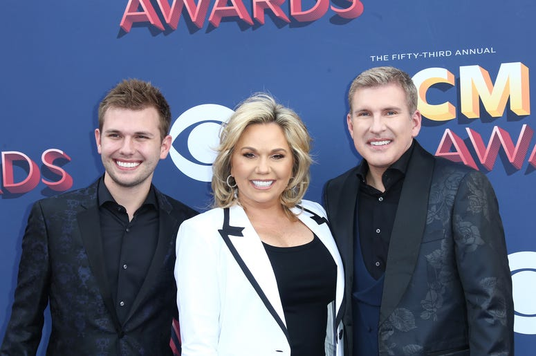 """Reality TV stars Todd (far right)  and Julie Chrisley (middle) of """"Chrisley Knows Best"""" have been indicted by a federal grand jury in Atlanta"""