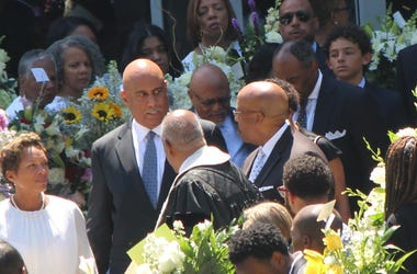 Dr. Christopher Edwards is seeing exiting the funeral of his two children and ex-wife