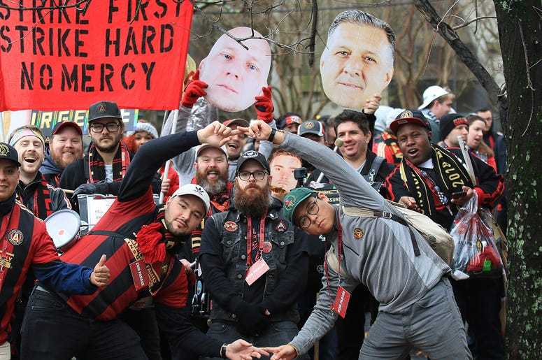 Atlanta United fans celebrate during victory parade
