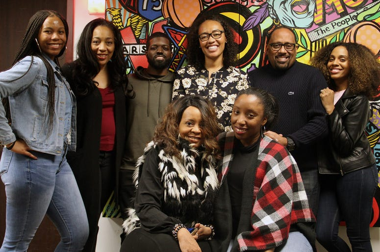 The producers, news, traffic and on-air talent of V-103's The Morning Culture