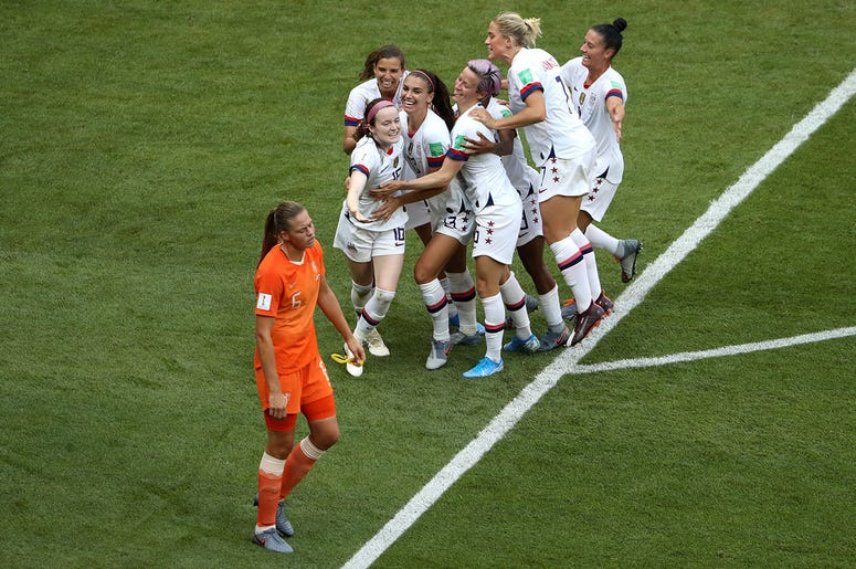 Rose Lavelle of the USA celebrates with teammates after scoring her team's second goal during the 2019 FIFA Women's World Cup France Final match between The United States of America and The Netherlands at Stade de Lyon on July 07, 2019 in Lyon, France