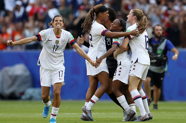 Tobin Heath of the USA celebrates with teammates following the 2019 FIFA Women's World Cup France Final match between The United States of America and The Netherlands at Stade de Lyon on July 07, 2019 in Lyon, France