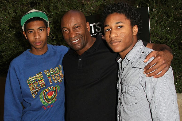 """Director John Singleton (C), Kofi Washington(L) and Maasai Singleton (R) arrives at the Los Angeles Premiere of """"Beats, Rhymes, & Life: The Travels Of A Tribe Called Quest"""" on June 24, 2011 in Los Angeles, California."""