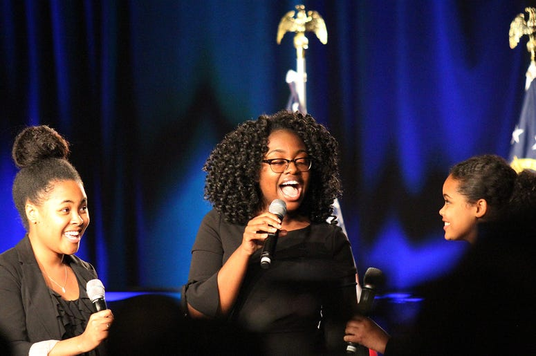 """Students sing """"Lift Every Voice and Sing"""" at Stacey Abrams' election night campaign party"""