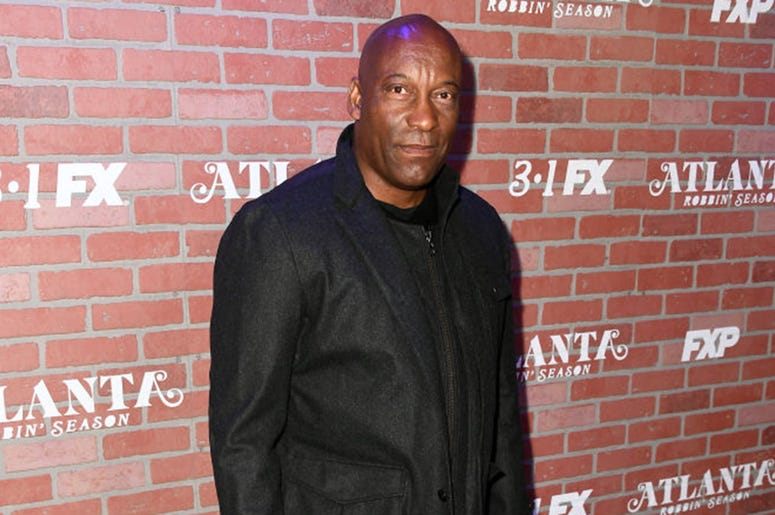 "John Singleton attends the premiere for FX's ""Atlanta Robbin' Season"" at The Theatre at Ace Hotel on February 19, 2018 in Los Angeles, California."