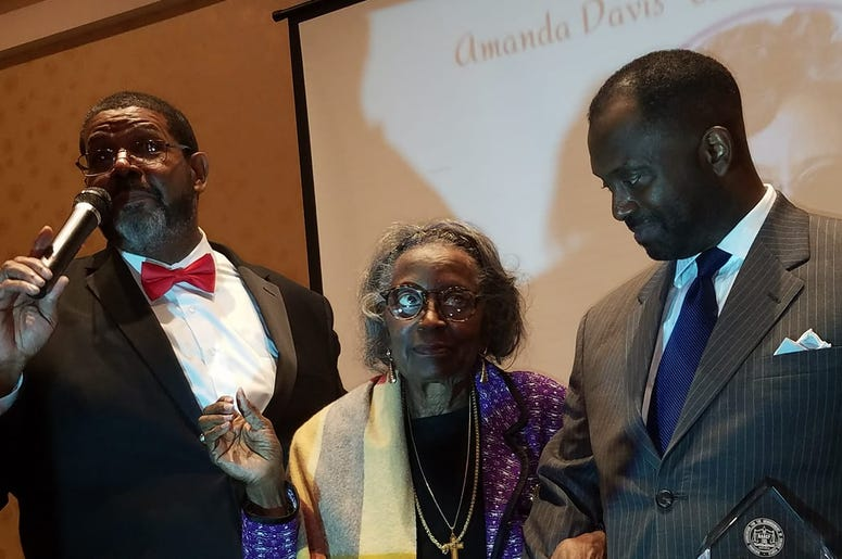 Mrs.Juanita Abernathy is flanked by Fulton County Commissioner Michael Lankford (l) and her son Kwame Abernathy (r) during award presentation in February 2019