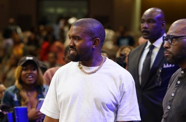 Rapper Kanye West (l) appears on stage with Dr. Jamal Bryant (r) Pastor of New Birth Missionary Baptist Church
