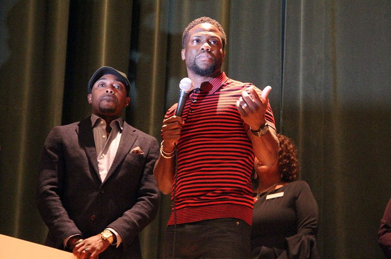 Kevin Hart speaks to Langston Hughes High School students