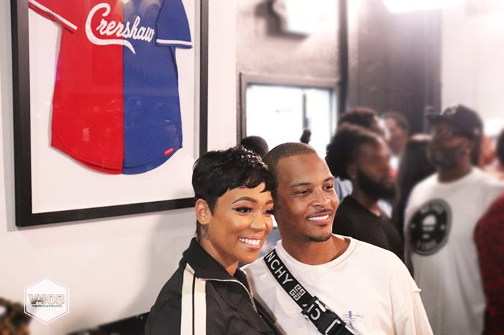 Monica and T.I At The Nipsey Hussle Trap Music Museum