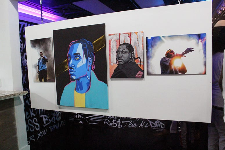 A wall of artwork and photography of Virginia rapper Pusha T inside T.I.'s Trap Music Museum