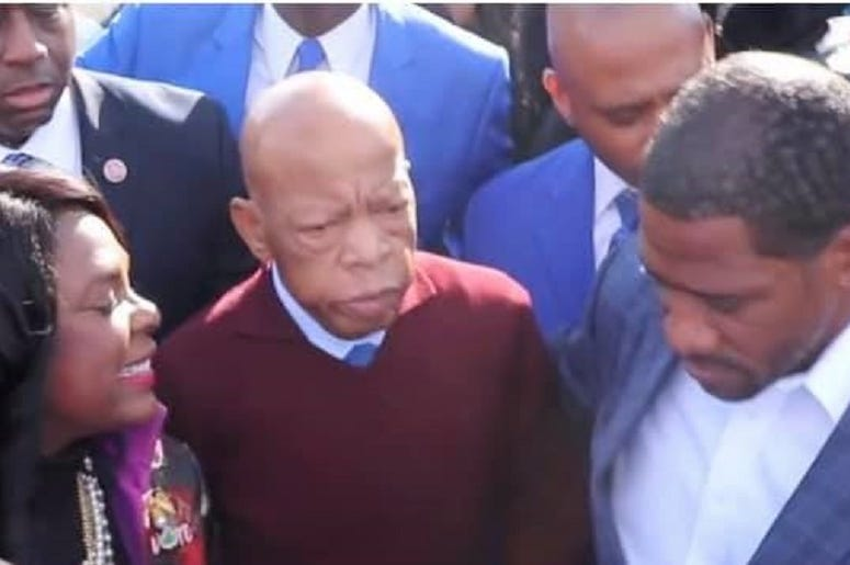 Congressman John Lewis prepares to join the many thousands on the Pettus Bridge