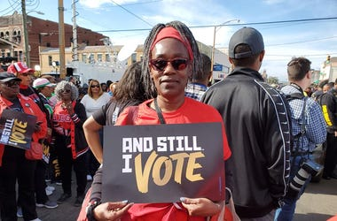 An attendee is shown at the 55 year observance of the March for Voter Rights in Selma, ALhts in