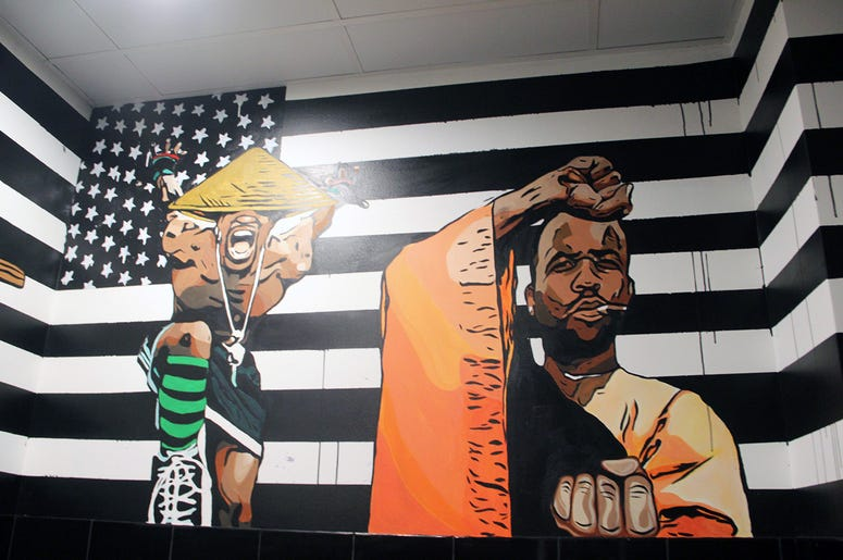 A mural of OutKast in the restroom at Slim & Husky's on Howell Mill Road in Atlanta