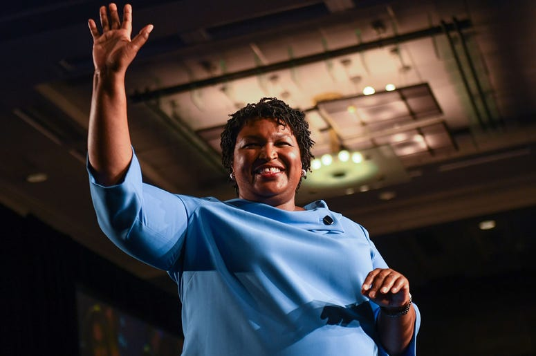 Democratic Georgia gubernatorial candidate Stacey Abrams addresses the crowd in the early morning hours on Wednesday morning at the Hyatt Regency Hotel in downtown Atlanta, GA