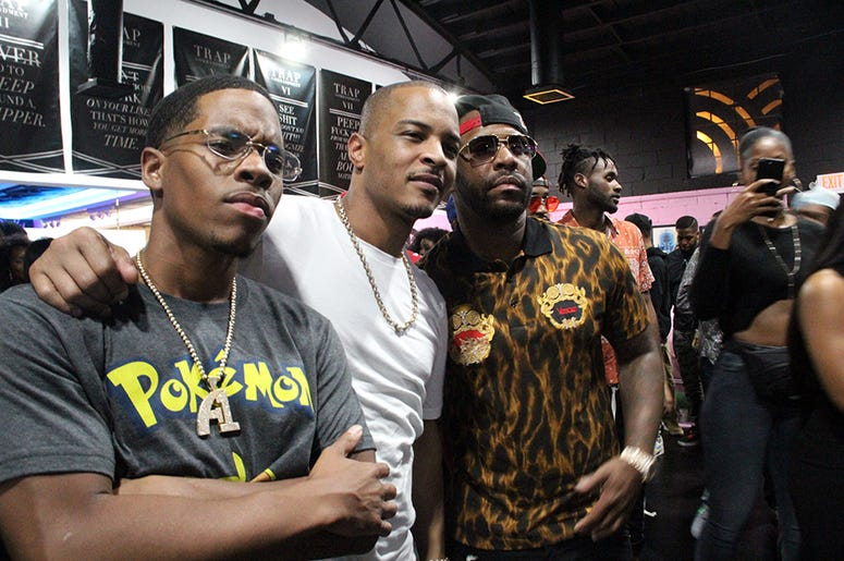 T.I. poses with Atlanta rapper Rocko inside his Trap Music Museum