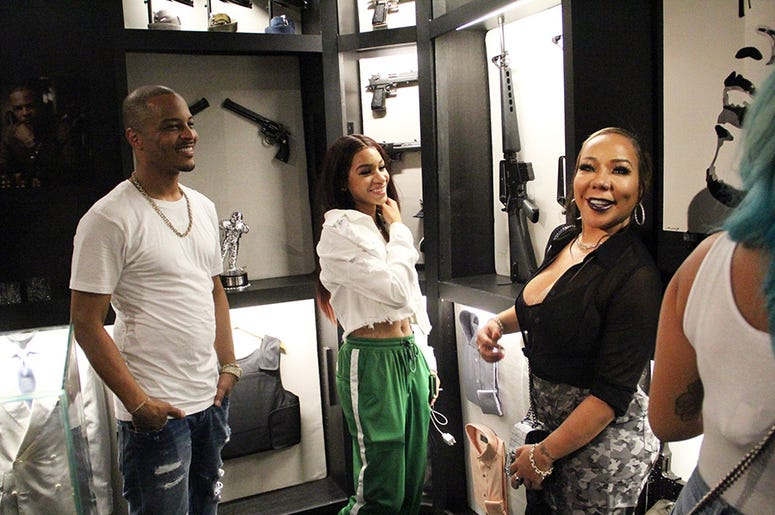 T.I. and family inside a recreated model of his former home closet, inside his Trap Music Museum