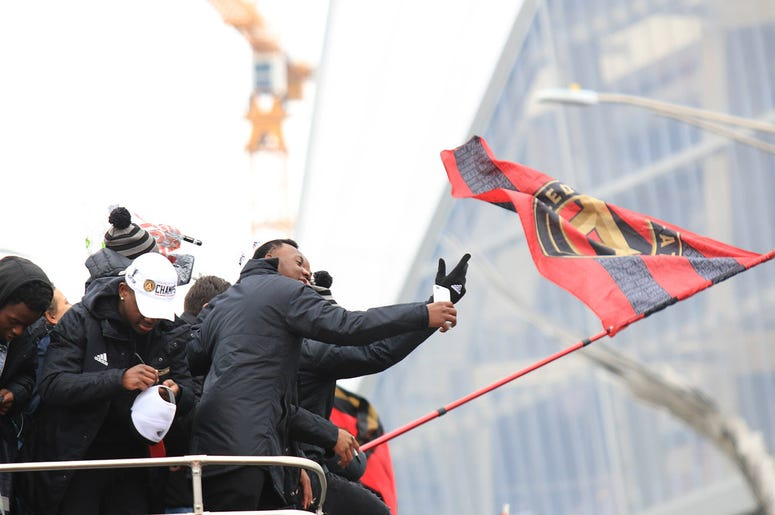 Atlanta United team members celebrate during victory parade