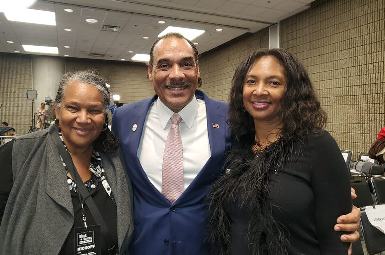 Loretta Grier Cudjoe of Macon is joined by fellow Trump supporters Bruce and Sharon Levell during the President's Atlanta visit Friday
