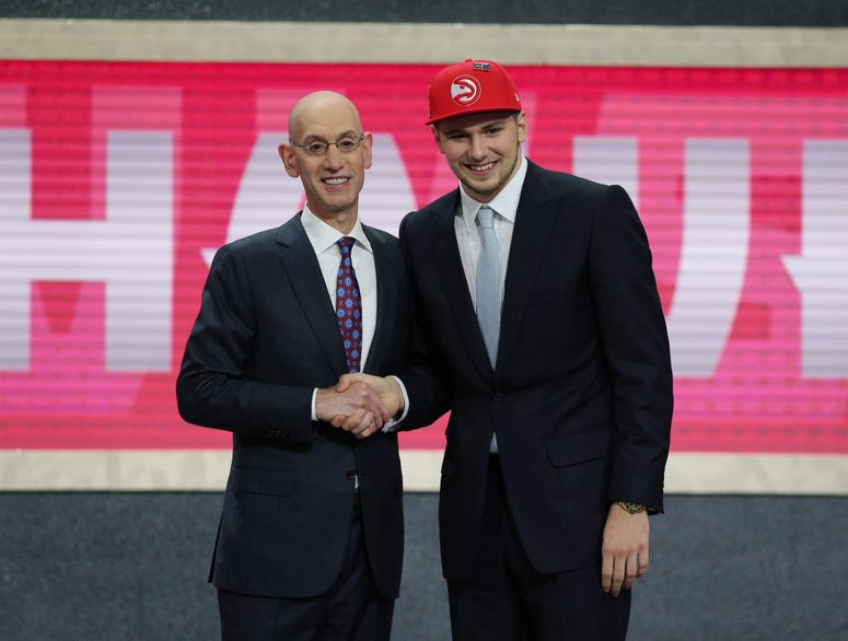 Luka Doncic greets NBA commissioner Adam Silver after being selected as the number three overall pick to the Atlanta Hawks in the first round of the 2018 NBA Draft at the Barclays Center