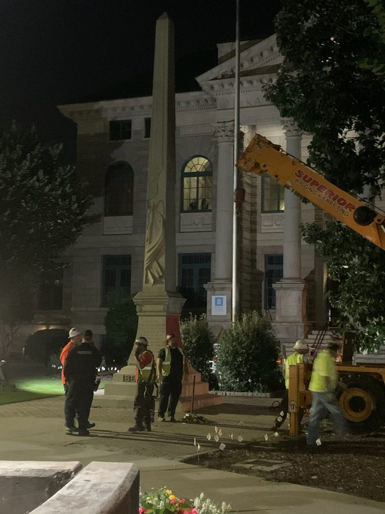 The top of the Confederate monument in Decatur Square was the first portion removed