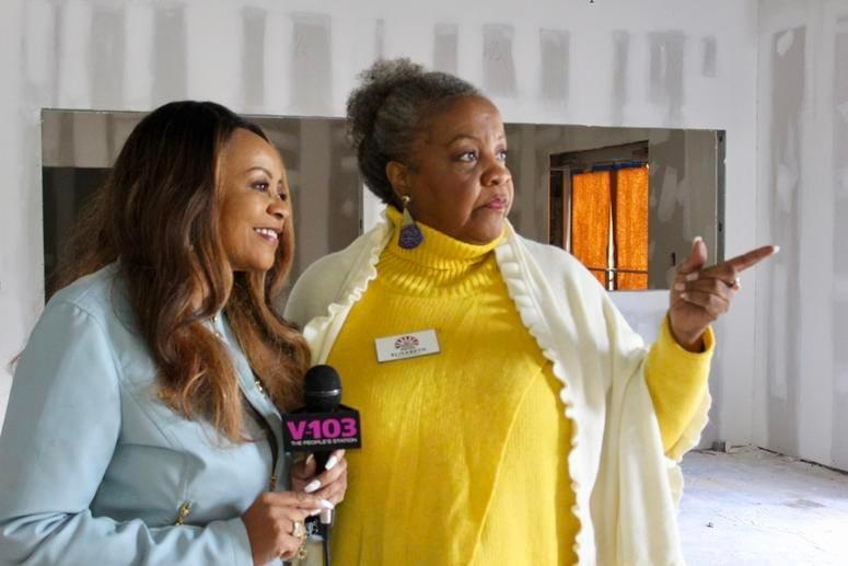 Hosea Helps CEO and President Elisabeth Omilami gives Entercom Atlanta's Maria Boynton a tour of what will be the new facility