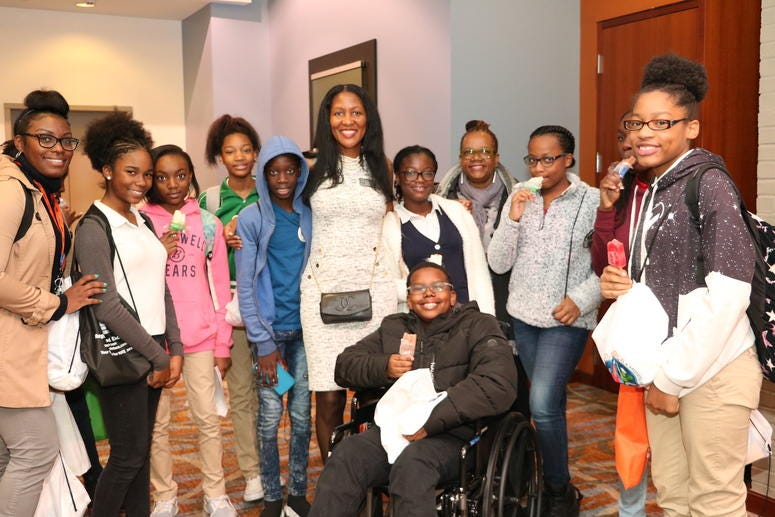 Fulton Commissioner Natalie Hall is shown with teens during a previous CEO's conference