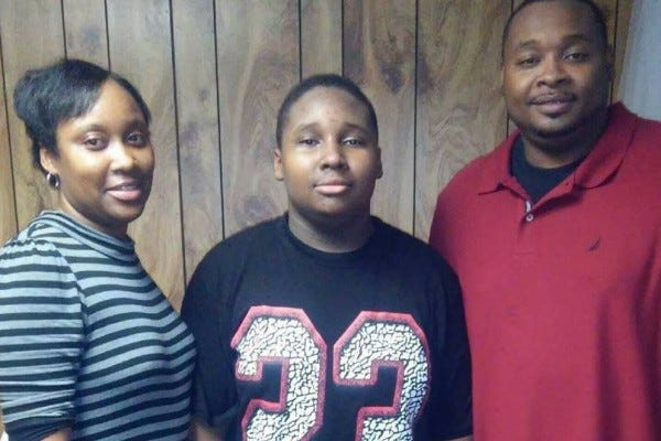 Johnny Tolbert (middle) collapsed, and later died, while playing football at an Atlanta park in July 2016