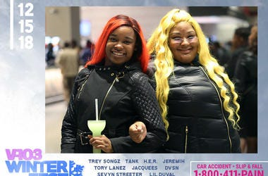 Two ladies attend #V103Winterfest in Atlanta on December 15, 2018