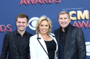 "Reality TV stars Todd (far right)  and Julie Chrisley (middle) of ""Chrisley Knows Best"" have been indicted by a federal grand jury in Atlanta"