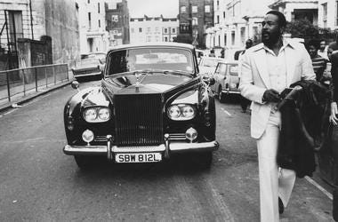 6th October 1976: American soul singer Marvin Gaye (1939 - 1984) walking ahead of his Rolls Royce in Notting Hill, London
