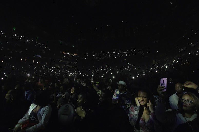 The crowd illuminates State Farm Arena with phones at V-103 Winterfest 2018