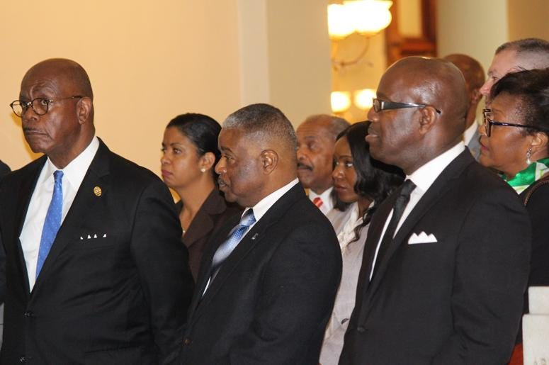 Fulton County District Attorney Paul Howard (l) and Ebenezer Church Sr. Pastor Dr. Raphael Warnock (r) remembered Johnson