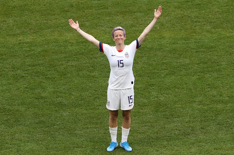 Megan Rapinoe of the USA celebrates with teammates after scoring her team's first goal during the 2019 FIFA Women's World Cup France Final match between The United States of America and The Netherlands at Stade de Lyon on July 07, 2019 in Lyon, France.