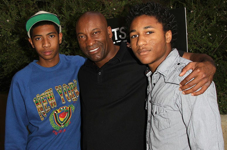 "Director John Singleton (C), Kofi Washington(L) and Maasai Singleton (R) arrives at the Los Angeles Premiere of ""Beats, Rhymes, & Life: The Travels Of A Tribe Called Quest"" on June 24, 2011 in Los Angeles, California."