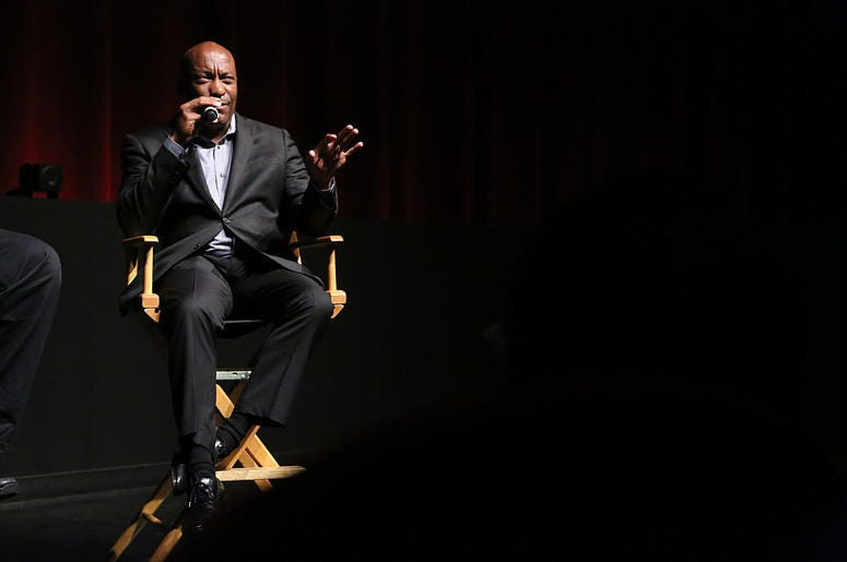 "Director John Singleton attends a discussion at the ""Spotlight On Screenwriting: Boyz n the Hood 25th Anniversary Screening With John Singleton And Walter Mosley"" presented by The Academy Of Motion Picture Arts And Sciences at SVA on June 12, 2016 in New"