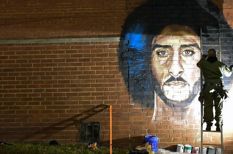 "Artist Fabian Williams paints a new Colin Kaepernick mural in response to his ""Kaeplanta"" mural being demolished on Feb 1 before Super Bowl 53"