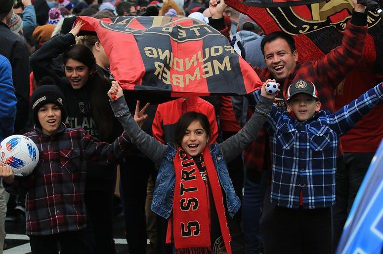 Atlanta United fans celebrate during victory parade