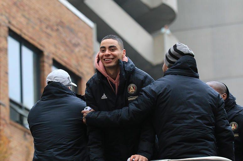 Atlanta United midfielder Miguel Almirón celebrates during victory parade