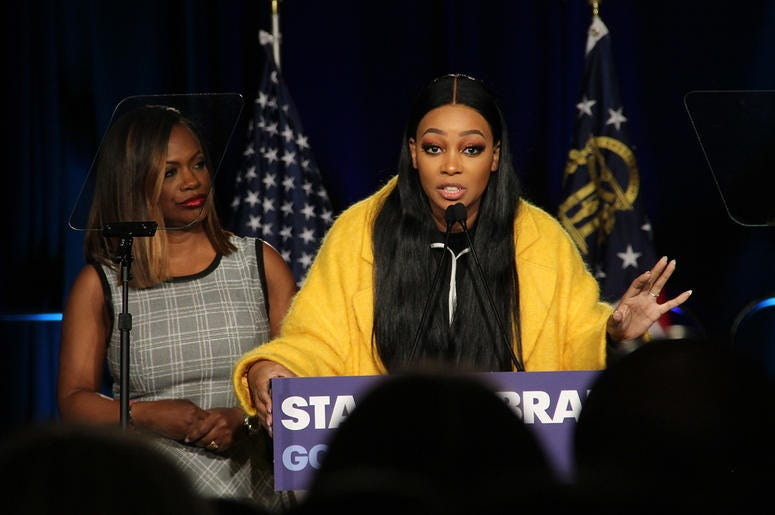 Singer Monica speaks to attendees at Stacey Abrams' election night campaign party