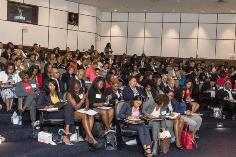 Attendees listen intently to keynote speaker Hill Harper during the 2018 NBMBAA Symposium in Atlanta