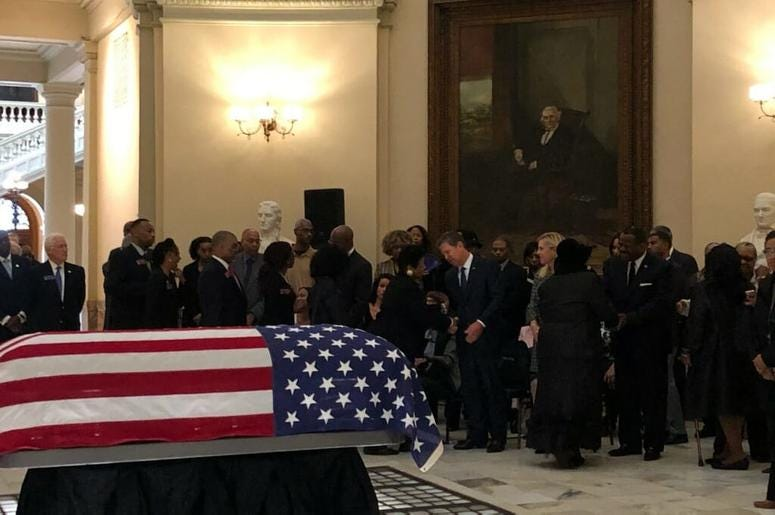 The flag draped coffin of former GA State Senator Leroy Johnson sits inside the Capitol rotunda