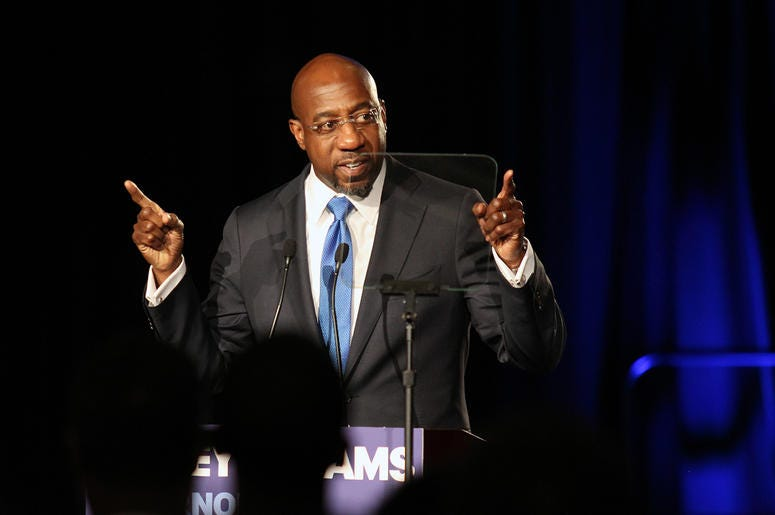 Reverend Raphael Warnock of Ebenezer Baptist Church speaks at Stacey Abrams' election night campaign party