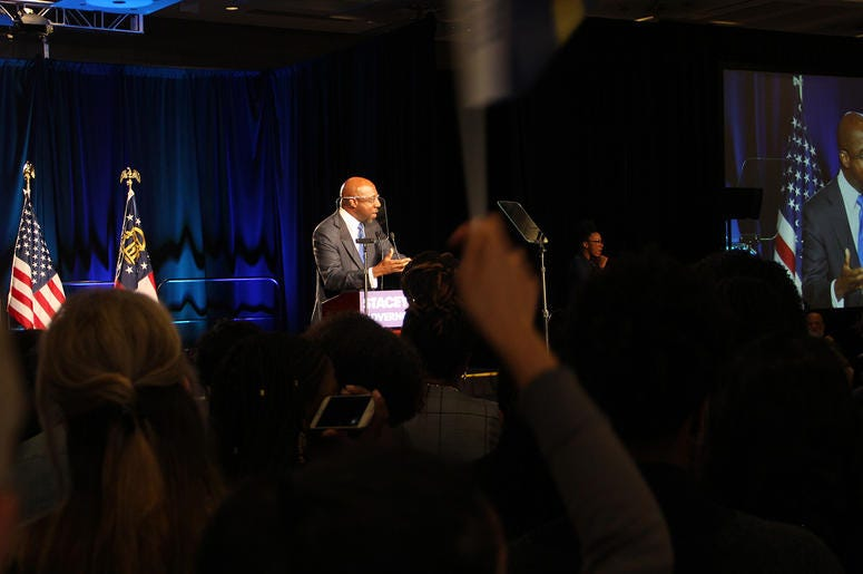 Reverend Raphael Warnock of Ebenezer Baptist Church speaks to crowd at Stacey Abrams' election night campaign party